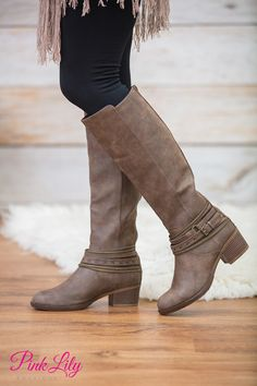 These edgy boots are such a beautiful way to welcome fall! The distressed shade of brown is so perfect for rocking with jeans, while the decorative golden zippers, buckle, and faux suede straps at the ankle add an extra pop of edgy style!