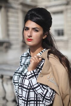 Andrea, a London pattern design student, instantly caught our eye at this season's London Fashion Week. Her bold graphic check shirt treads the line between ladylike chic and mod-style bold. Pairing this with Ronettes' style beehive and tailored camel coat, she's top of the style league tables. Andrea wears our gold Mini Cherub Praying ring - if you like her September style, share and like her image on our Facebook Fanpage to vote for her to win her favourite Bill Skinner item.