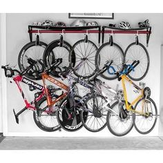 bike rack storage for garage, just not sure how far they would stick out from the wall.