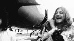 ♡♥Young Robert Plant of Led Zeppelin smiles outside by the plane - click GIF♥♡