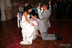 San Diego wedding photographer http://www.shadowcatchrimagery.com Garter removal