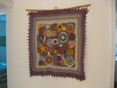 Freeform crochet wall hanging by lisaviolinviola