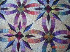 wedding ring quilt pattern | The edges of the quilt all follow the curved piecing, and so there ...