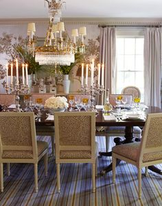 Gray doesn't have to be dull. Designer Andrew Raquet decided to glam up the color in this Brookville, New York, home. In this dining room, he chose silver, gold, and lavender tones to accent the gray, for a luxurious feel.