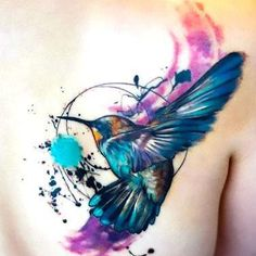 Amazing Splashy Hummingbird Tattoo Idea