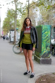 Intarsia Knit sweater, short pleated black skirt, biker jacket and matching sports shoe, worn with white collar shirt for a touch of class.  Paris urbanista #waynetippetts