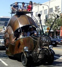 Holy Crap! This is the most awesome thing I've seen...like...ever! A giant, functional, steampunk snail car.