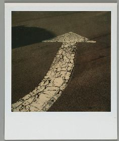 [Street Arrow] - Instant color print - 1973-74.  Walker Evans