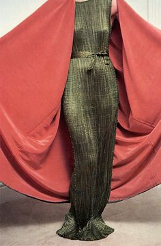 Fortuny mantle over a belted silk satin Delphos.  The Delphos silk belts were stenciled in gold or silver. The mantle lining, mostly in silk...