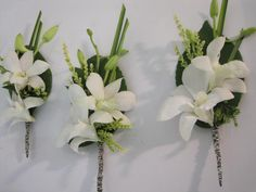 Boutonniere - White Orchids with a mix of green (INSTEAD OF WHITE DO PURPLE-BLUE ORCHIDS.... YES)