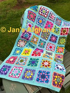 Kaleidoscope crocheted afghan kaleidoscope granny squares multi-colored with sea green (turquoise/aqua) border MADE TO ORDER. $150.00, via Etsy.