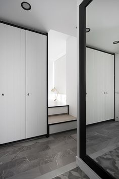 Walk in wardrobe | Platform bed | A clean and crisp Singapore apartment