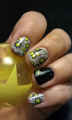 White base with black flower stamps and yellow dots --can't wait to get my nail stamps in the mail to try things like this!