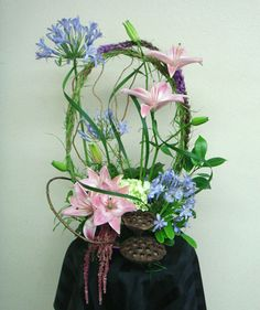 Lilies and Agapanthus Arrangement Beautiful Flower Arrangements, Wedding Arrangements, Floral Arrangements, Beautiful Flowers, Fresh Flowers, Silk Flowers, Agapanthus, Floral Centerpieces, Flower Ideas