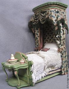 Child's bed from the Rigg Dolls House. (this is lovely - what we try to achieve today and then call shabby chic)