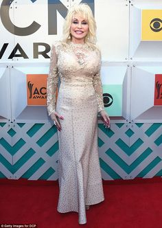 Dolly Parton: Red carpet at 51st Academy of Country Music Awards at MGM Grand Garden Arena on April 3, 2016 - Stylish look: The 70-year-old shined in the fitted long-sleeved embellished dress, which cinched at her waist before cascading down to the ground