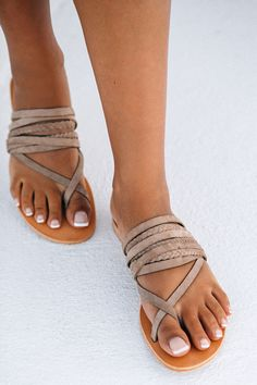 Channel your inner goddess with the Deck Slides. These casual slip-on flats feature a toe post with multiple thin and braided cross-over straps  made from a soft nude suede. Exclusively by Wanted Shoes x Sabo Skirt