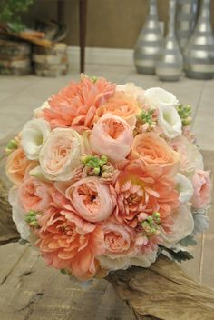 Bridal bouquet with dahlia, garden roses, lisianthus, stocks and dusty millers. Designed by Forget-Me-Not Flowers.