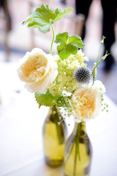 Wine Bottle Arrangement by Antheia Floral Design: garden roses, queen anne's lace and thistle in wine bottles