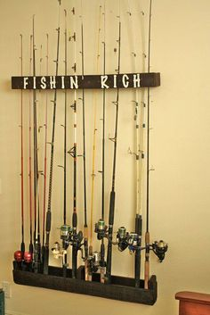 """A simple fishing pole wall rack made from a pallet. Stained with Minwax """"walnut. A simple fishing pole wall rack made from a pallet. Stained with Minwax """"walnut"""" stain and ste Diy Fishing Rod Holder, Fishing Pole Storage, Ice Fishing Rods, Fishing Poles, Fly Fishing, Fishing Tackle, Fishing Guide, Fishing Gifts, Women Fishing"""