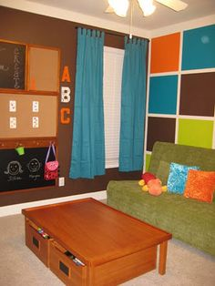 Love these colors for a playroom or family area. we have that futon but in brown that would match this, too!