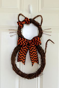 Please note: You will receive only one Cat wreath. Pictures shown example of the style available. This perfectly cute, Grapevine Kitty Cat wreath is perfect for your front door, to hang on the wall, interior door. Her name is kitty BOO. She is really whimsical and not too spooky for Halloween. This wreath is shaping and assembling by me from start to finish. This is my original one I made so more style will come out in the future. It a little harder than bunny wreath to shape it. You can…