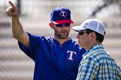 Texas Rangers General Manager Jon Daniels (right) talks with former Rangers infielder Michael Young during a spring workout at the team's training facility on Tuesday, March 1, 2016, in Surprise, Ariz. (Smiley N. Pool/The Dallas Morning News)