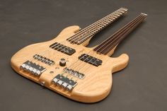 Double-neck 5 string fretted + 4 string fretless by Combat Guitars