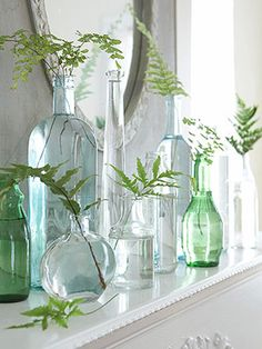 love the fresh simple feel of these bottles and greenery for a different display