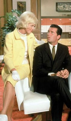 Doris Day, Jim Garner    I think her best side kick is this guy- James Garner...they seem to have the same type of personality and ways of saying and doing  things alike....besides that he's a H.U.N.K.