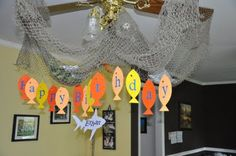 fish net chandelier + paper fish hung with paper clip hooks