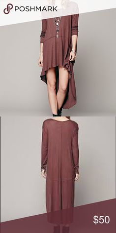 "Free People Amy's Long Sleeve Tee Dress Oversized and effortless, American made long sleeve tee dress in a super soft ribbed jersey. Exaggerated hi-lo hem. 65% polyester, 35% rayon. Color is called ""slit"". Free People Dresses"