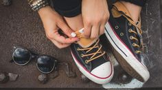 Converse black and tan sneakers with urban outfitters sunglasses for summer style