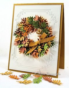 Die cut a  ring with Nestabilities to act as the base and a guide for wreath.  Punch out several leaves in mustard, rust, olive and pumpkin and adhere.
