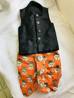 Black kurtha with orange kalamkari dhoti pant