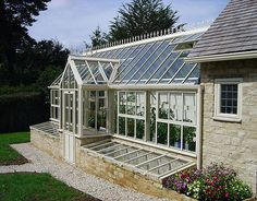 Love the cold frames on the front of this lovely greenhouse #glass_house #greenhouse