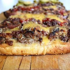 """LONG BOY BURGERS **These were tasty! Just used about C cheese on all 8 sandwiches.--KS** """"long boy 'burgers'"""" Seasoned ground beef baked in a sub roll with melty cheese. I Love Food, Good Food, Yummy Food, Tasty, Beef Dishes, Food Dishes, Main Dishes, Great Recipes, Favorite Recipes"""