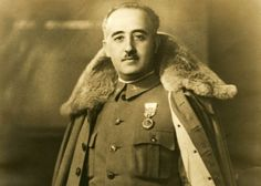 Photograph of General Franco with winter cloak.