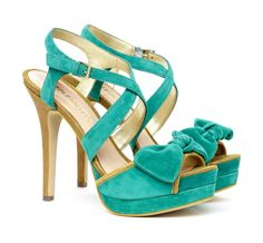 Open toe heel in teal suede with bow detail.