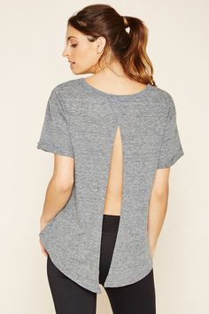 "An athletic knit crop top complete with short sleeves, rolled trim, and a hem ""Believe"" graphic."