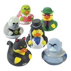 """Super Villain Rubber Ducks - $6.00 : """"The Duck"""" may resemble The Penguin but with one clear difference, he is a duck. The Exclaimer makes sure his point is known! Cat Duck is a sly jewel thief who knows diamonds are a girl's best friend. Mr. Frozen duck demands your respect and only wants to be cool. Metal Duck has reconstructed his own body after Bat Duck flung him into a vat of boiling duck soup. Dex Duck's skin turned green in a lab accident."""