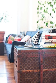 At the end of the black couch, a vintage Louis Vuitton steamer trunk acts as a side table. From Sneak Peek: Andrew and Gemma of Ingalls Photo