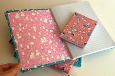 composition books covered in fabric! It works! Beautifully. With adhesive spray. Seriously, it's so easy!