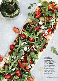 grilled flatbread with parsley pesto, arugula, tomatoes & goat cheese