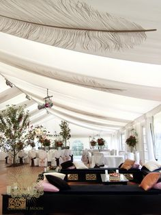 Our chill-out furniture and feather drapes at a summer wedding