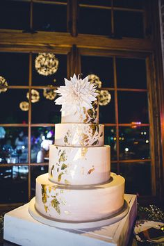 wedding cake with gold foil - photo by Izzy Hudgins Photography http://ruffledblog.com/handcrafted-sparkle-wedding-in-savannah