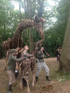 Giant walkabout puppet Dolly the Giraffe and her baby Juno at Bestival 2015. by @vippuppets