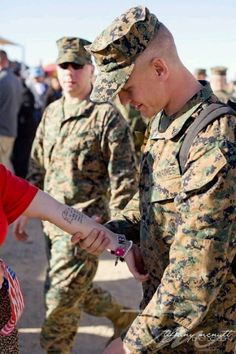 A husband seeing his wife's tattoo for the first time. She got part of a letter he had sent her while on deployment