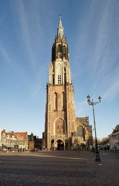 Delft's Nieuwe Kerk is somewhat hard to miss. It's the tallest structure in the city center. Though called the 'New Church', it's only about 135 years younger than the Old Church, and not all that new; construction began in the late 14th century. Click here to see more!  http://mikestravelguide.com/things-to-do-in-delft-visit-the-new-church-nieuwe-kerk/