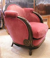 This gorgeous art deco rose velvet chair is a superb example of 1930's French craftsmanship. The dark stained mahogany has been beautifully carved in a spiral design, complimenting the soft rose colored fabric.